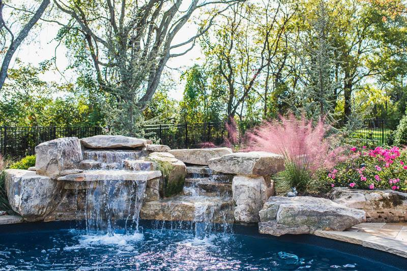 Photo of Luxury rock and water features spilling into In-ground pools and spas in Nashville, Franklin, Clarksville TN